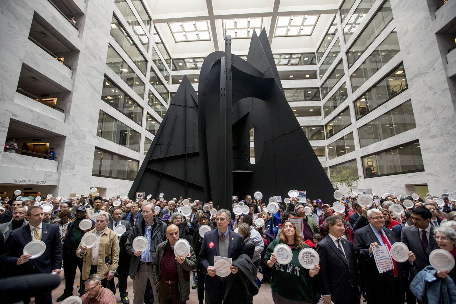 Furloughed government workers affected by the shutdown hold a silent protest against the ongoing partial government shutdown on Capitol Hill in Washington, Wednesday, Jan. 23, 2019. (AP Photo/Andrew Harnik)