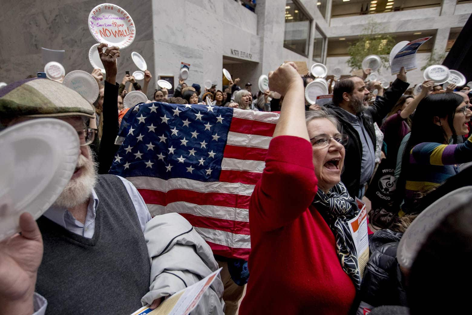 Furloughed government workers affected by the shutdown yell during a protest against the ongoing partial government shutdown on Capitol Hill in Washington, Wednesday, Jan. 23, 2019. (AP Photo/Andrew Harnik)