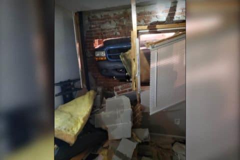 Truck crashes into Woodbridge house