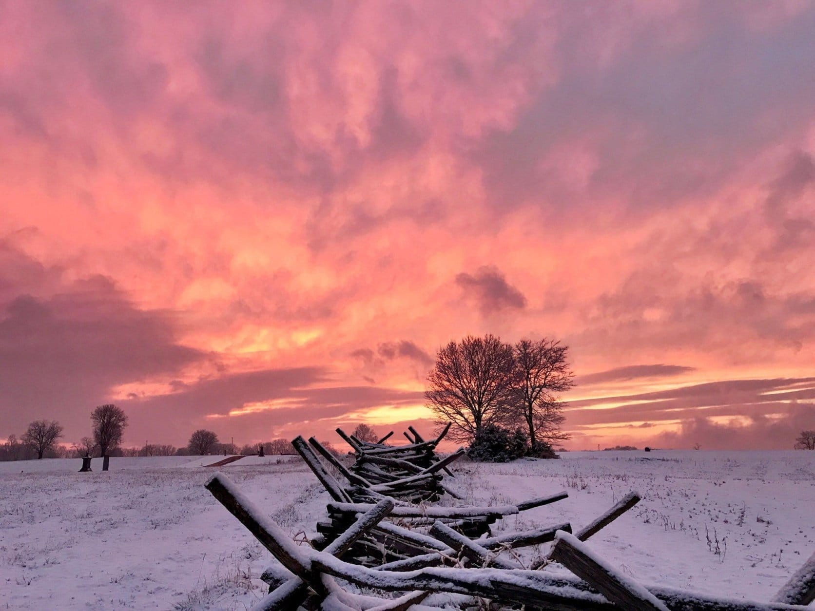 The sun sets over snowy Antietam National Battlefield in Maryland. (Courtesy @BackroadsRamblr via Twitter)