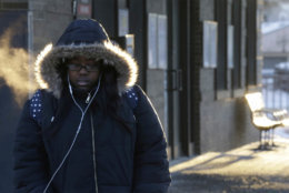 A commuter arrives at Metra Western Avenue station, Tuesday, Jan. 29, 2019, in Chicago. The extreme cold and record-breaking temperatures are crawling into a swath of states spanning from North Dakota to Missouri and into Ohio after a powerful snowstorm pounded the region earlier this week. (AP Photo/Kiichiro Sato)