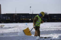 A worker shovels snow off the rail switches at the Metra Western Avenue Yard, Tuesday, Jan. 29, 2019, in Chicago. The extreme cold and record-breaking temperatures are crawling into a swath of states spanning from North Dakota to Missouri and into Ohio after a powerful snowstorm pounded the region earlier this week. (AP Photo/Kiichiro Sato)