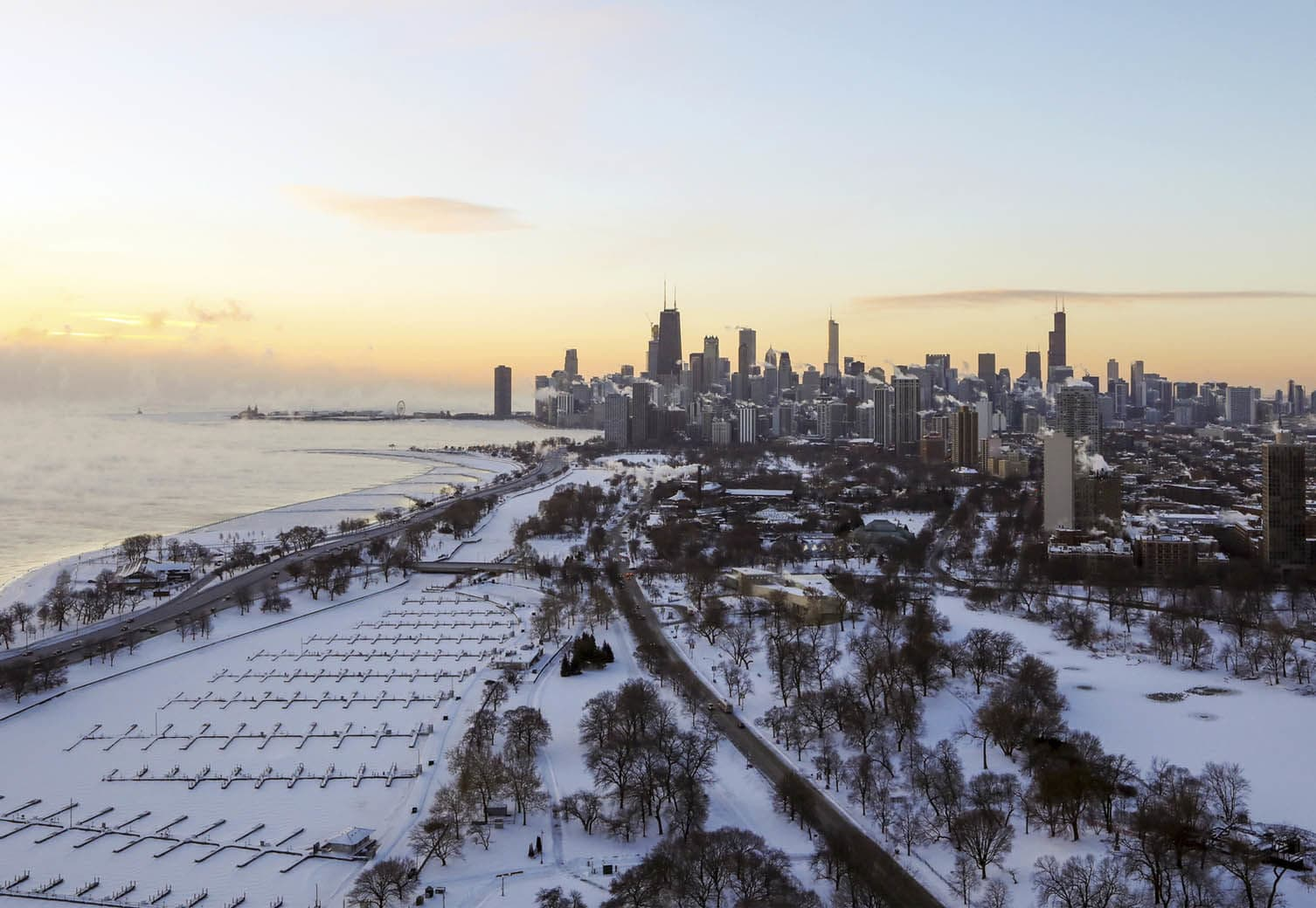 Chicago's lakefront is covered with ice on Wednesday, Jan. 30, 2019.  Temperatures are plummeting in Chicago as officials warn against venturing out into the dangerously cold weather. (AP Photo/Teresa Crawford)