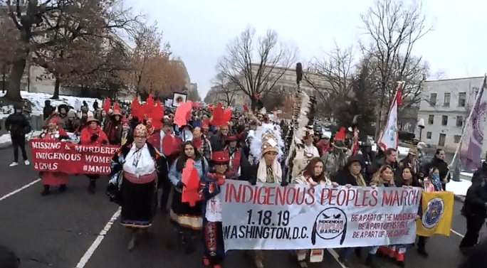 Activists proceed Friday during the Indigenous Peoples March. (Screengrab courtesy Lakota People's Law Project)
