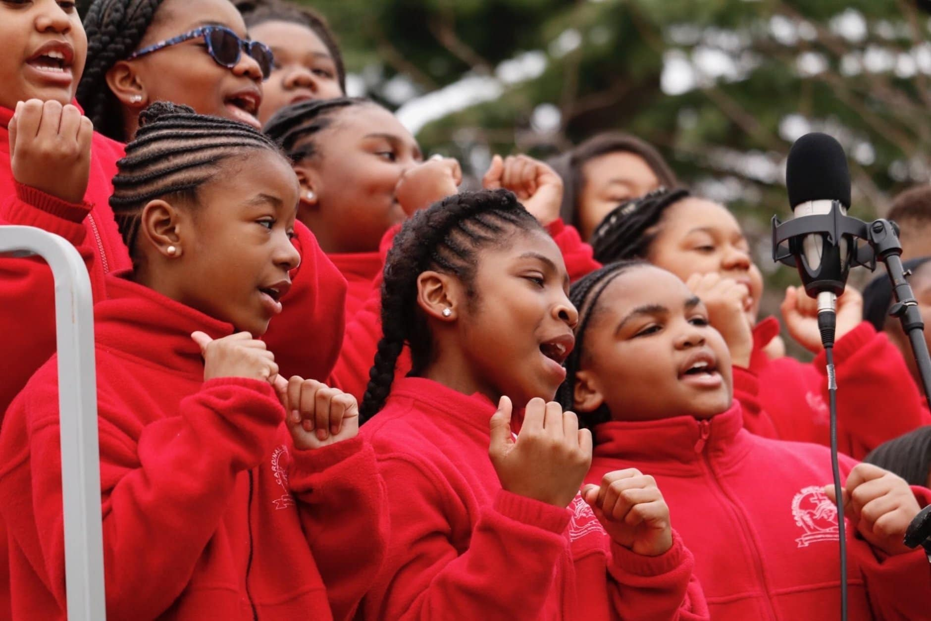 A section of the choir from Cardinal Shehan Catholic School from Baltimore gets the crowd warmed up before the inaugural speeches. (WTOP/Kate Ryan)