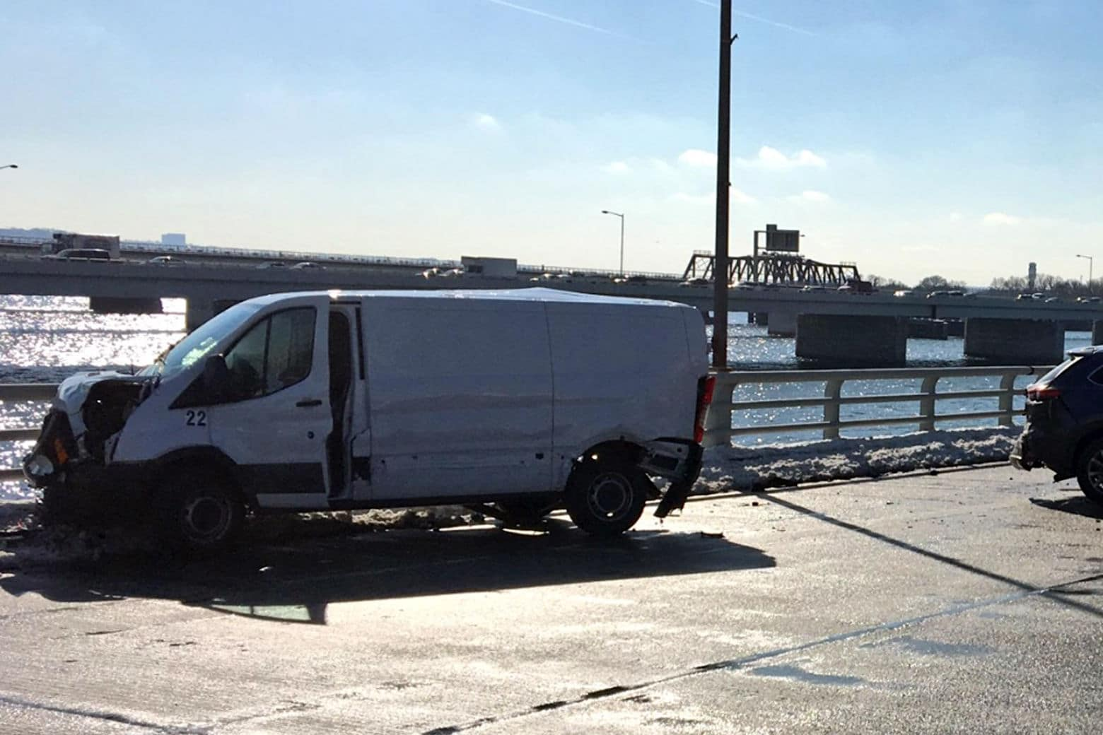 A van involved in the 14th Street Bridge crash Tuesday. (Authorities on the scene of a crash on the 14th Street Bridge on Tuesday. (Courtesy D.C. Fire and EMS))