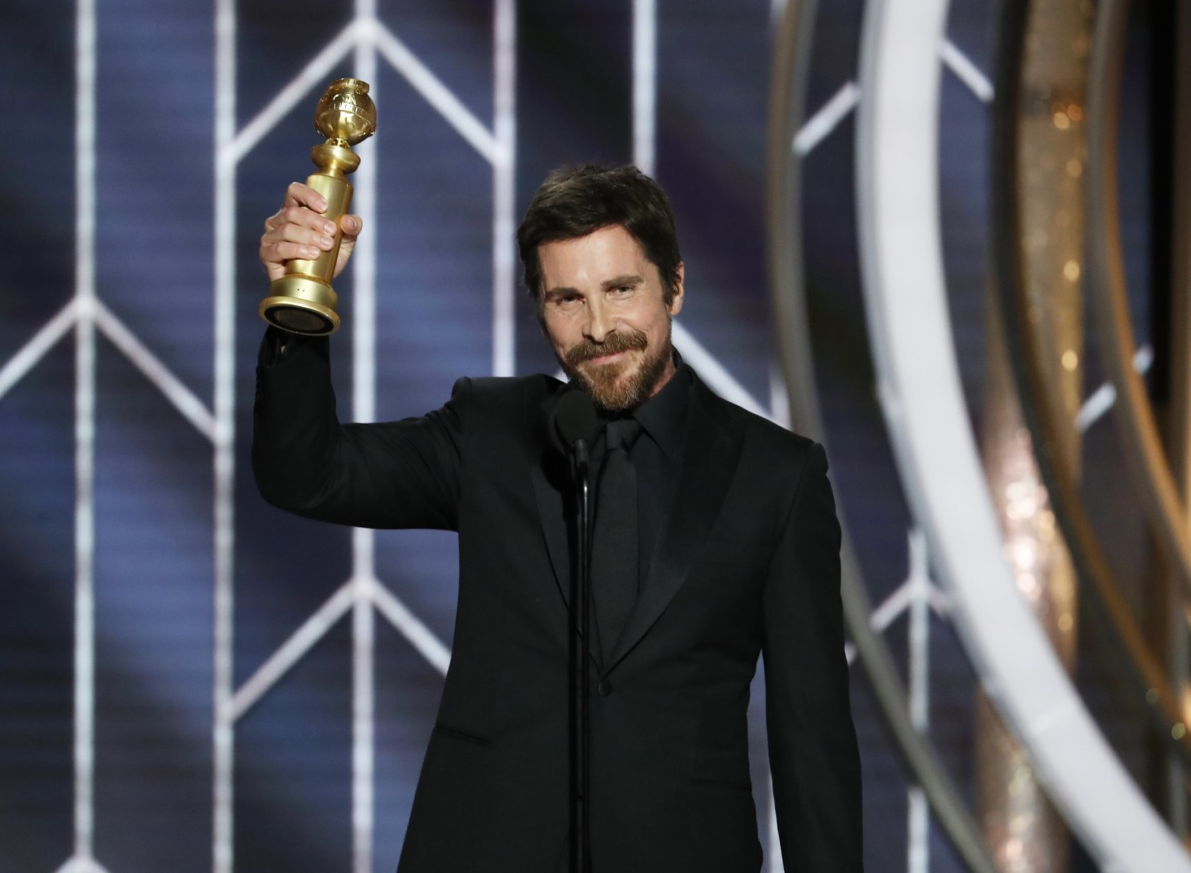 """This image released by NBC shows Christian Bale accepting the award for best actor in motion picture musical or comedy for his role in """"Vice"""" during the 76th Annual Golden Globe Awards at the Beverly Hilton Hotel on Sunday, Jan. 6, 2019, in Beverly Hills, Calif. (Paul Drinkwater/NBC via AP)"""