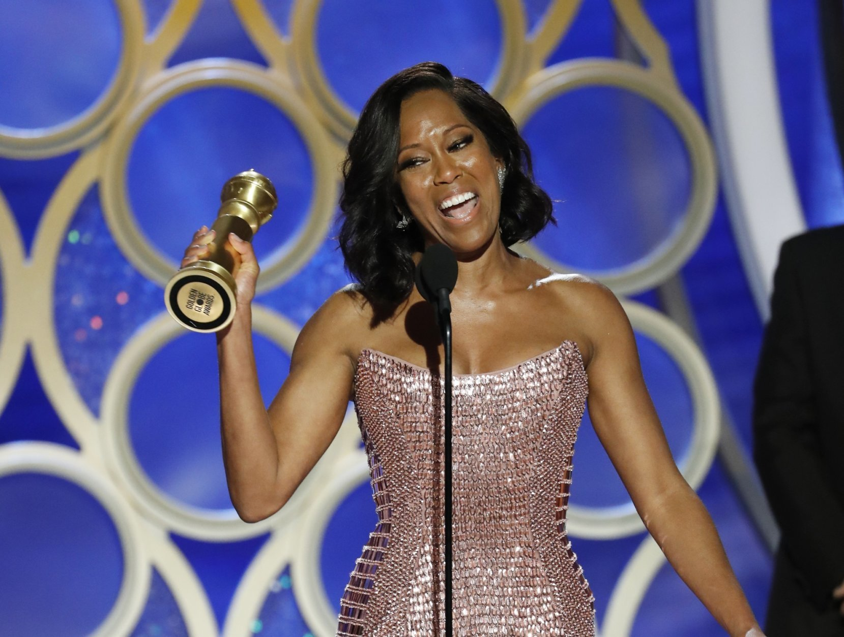 """This image released by NBC shows Regina King accepting the award for best supporting actress in a motion picture for her role in """"If Beale Street Could Talk"""" during the 76th Annual Golden Globe Awards at the Beverly Hilton Hotel on Sunday, Jan. 6, 2019 in Beverly Hills, Calif. (Paul Drinkwater/NBC via AP)"""