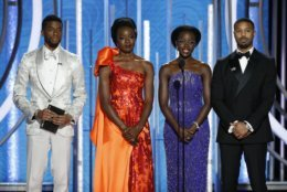 """This image released by NBC shows the cast of """"Black Panther,"""" from left, Chadwick Boseman, Danai Gurira, Lupita Nyong'o and Michael B. Jordan presenting the award for best animated feature during the 76th Annual Golden Globe Awards at the Beverly Hilton Hotel, Sunday, Jan. 6, 2019 in Beverly Hills, Calif. (Paul Drinkwater/NBC via AP)"""
