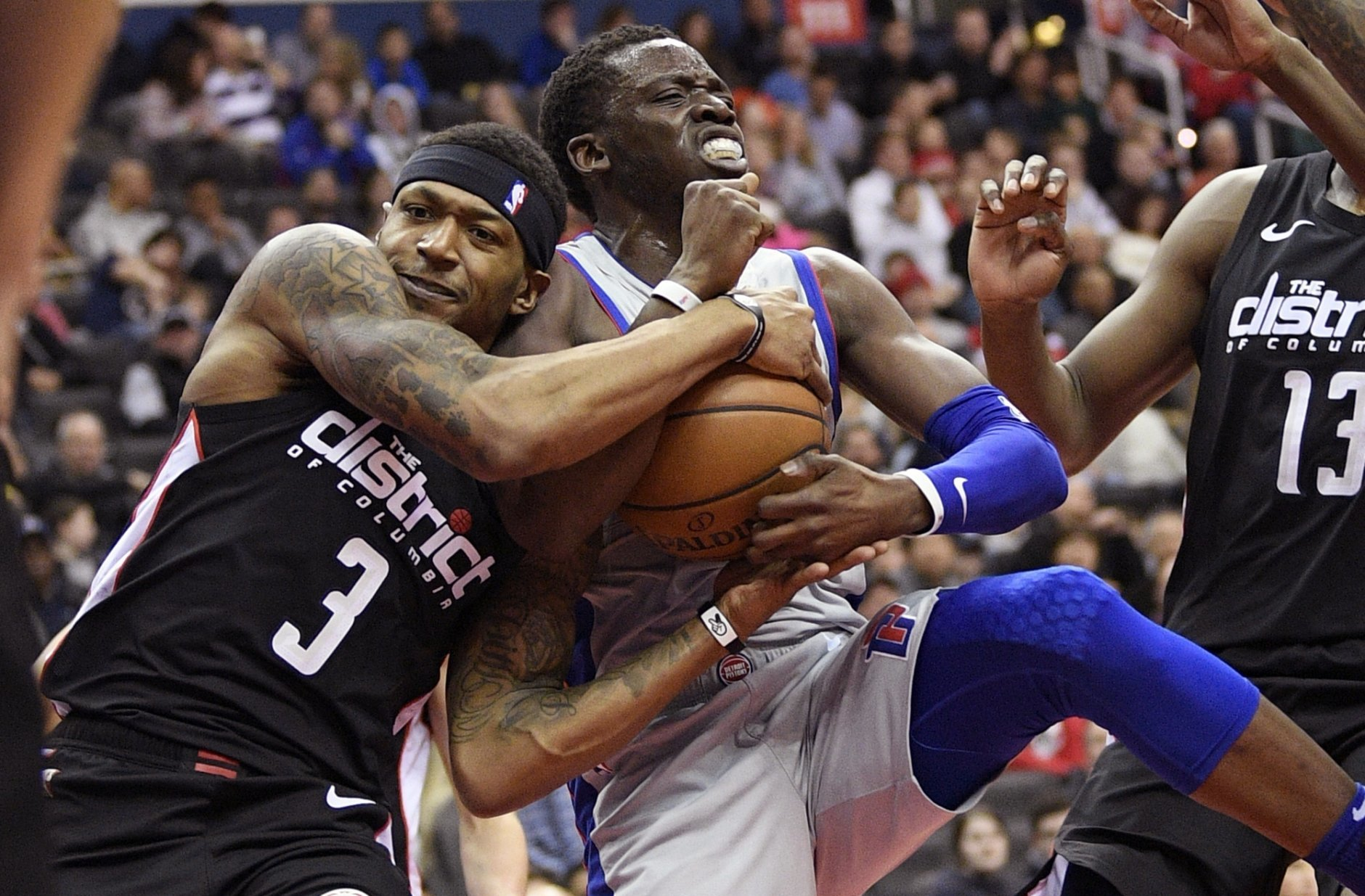 Washington Wizards guard Bradley Beal (3) battles for the ball against Detroit Pistons guard Reggie Jackson during the first half of an NBA basketball game, Monday, Jan. 21, 2019, in Washington. (AP Photo/Nick Wass)