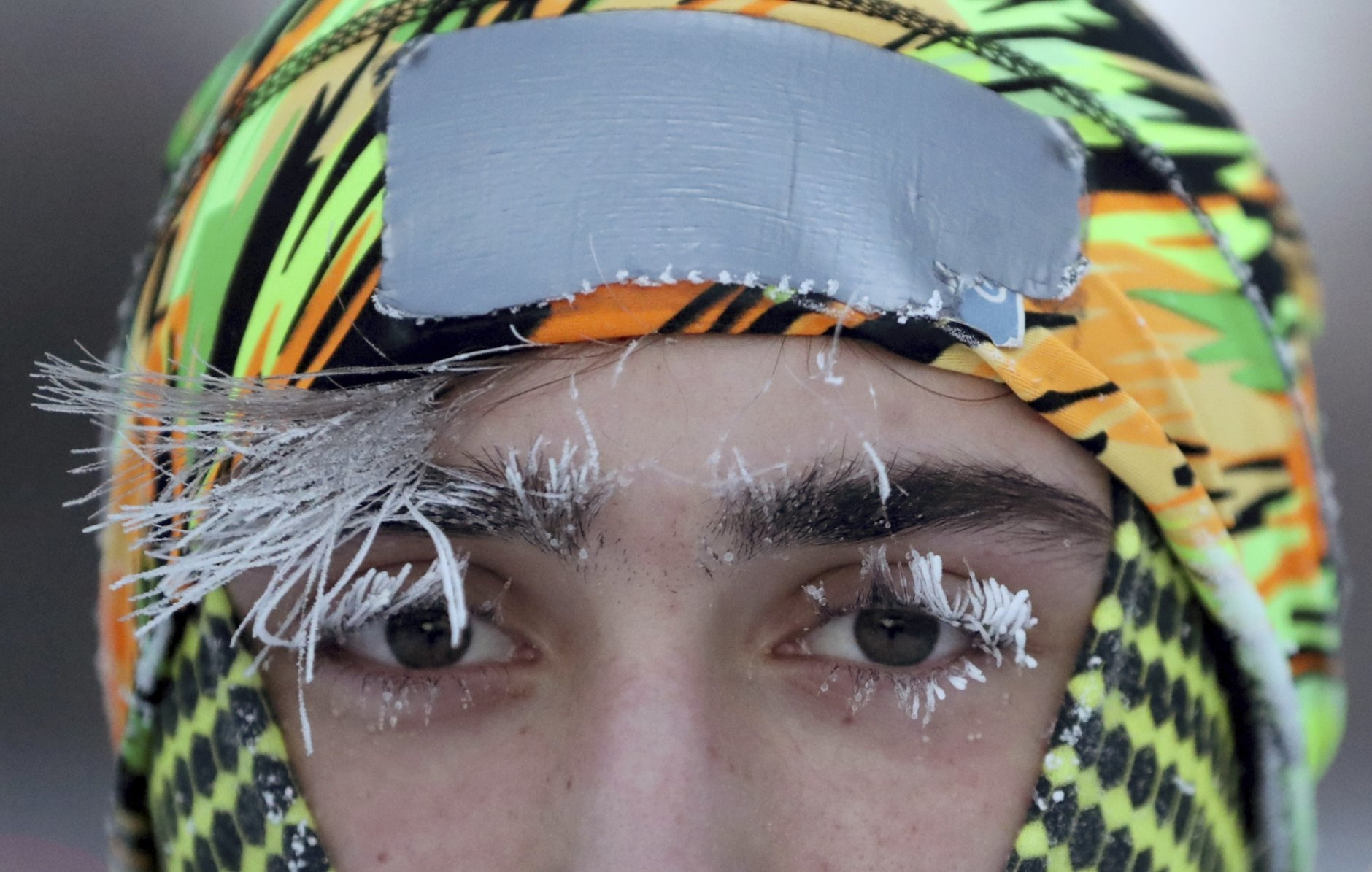 Frost covers part of the face of University of Minnesota student Daniel Dylla during a morning jog along Mississippi River Parkway Tuesday, Jan. 29, 2019, in Minneapolis. Extreme cold and record-breaking temperatures are crawling into parts of the Midwest after a powerful snowstorm pounded the region, and forecasters warn that the frigid weather could be life-threatening.  (David Joles/Star Tribune via AP)