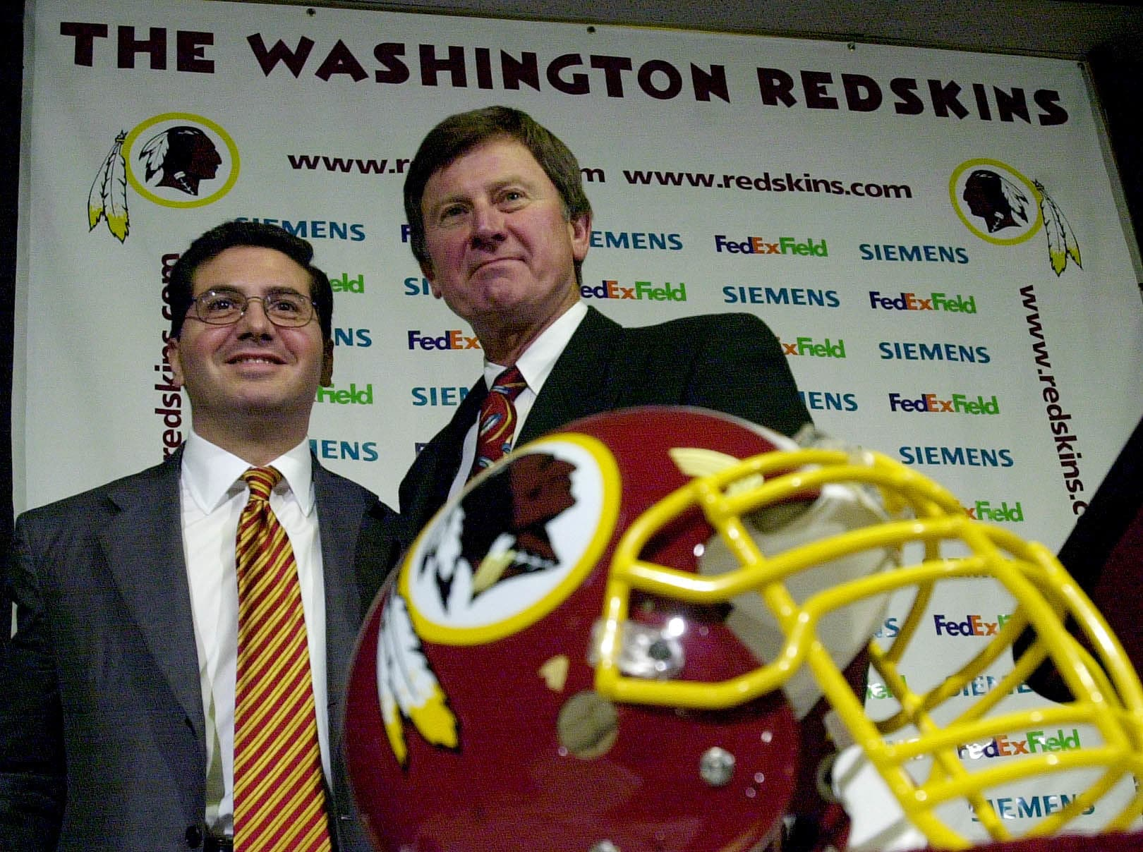 Steve Spurrier, right, is joined by Washington Redskins' owner Daniel Snyder during Spurrier's first news conference as the Redskins' head coach in Ashburn, Va  Tuesday, Jan. 15, 2002 . (AP Photo/Kenneth Lambert)