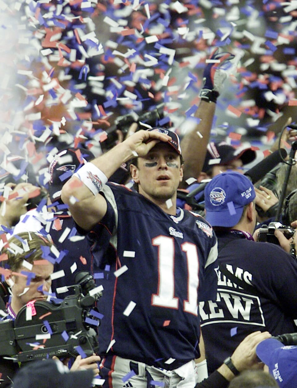 New England Patriots quarterback Drew Bledsoe (11) is covered up in confetti after the Patriots beat the St. Louis Rams in Super Bowl XXXVI at the  Louisiana Superdome Sunday, Feb. 3, 2002 in New Orleans.  (AP Photo/Beth A. Keiser)