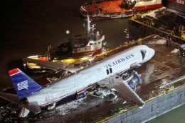 U.S. Airways flight 1549, an Airbus A320 that made an emergency landing Thursday in the Hudson River sits on a barge after being lifted out of the river in New York, Sunday, Jan. 18, 2009. (AP Photo/Kathy Willens)