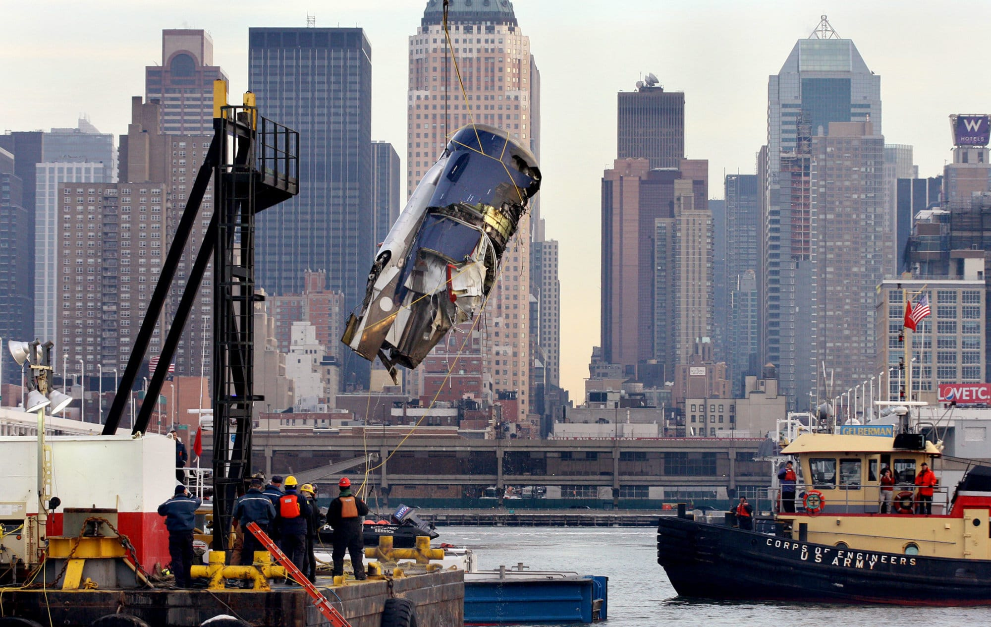 From the deck of the U.S. Army Corps of Engineers Hayward, the engine of US Airlines Flight 1549 that crash landed into the water on Jan. 15 can be seen as it is retrieved from the icy Hudson River in New York Friday, Jan. 23, 2009. (AP Photo/Craig Ruttle)