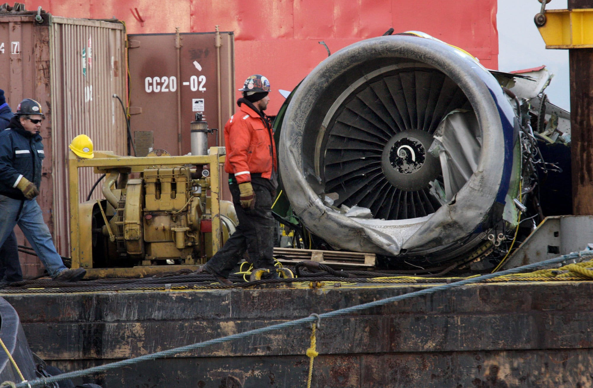 ** ADVANCE FOR TUESDAY, MAY 26 AND THEREAFTER ** FILE - In this Jan. 23, 2009 file photo, the engine of US Airlines Flight 1549 that crash landed into the water on Jan. 15 can be seen resting on a barge after it was retrieved from the icy Hudson River in New York by salvage crews. About 700 yards from the end of a LaGuardia Airport runway, where thousands of planes take off and land, New York officials want to build what could be the equivalent of a bird magnet: A very large garbage transfer station. This, just five months after a run-in with birds sent a jet full of people into the Hudson River. (AP Photo/Craig Ruttle, FILE)