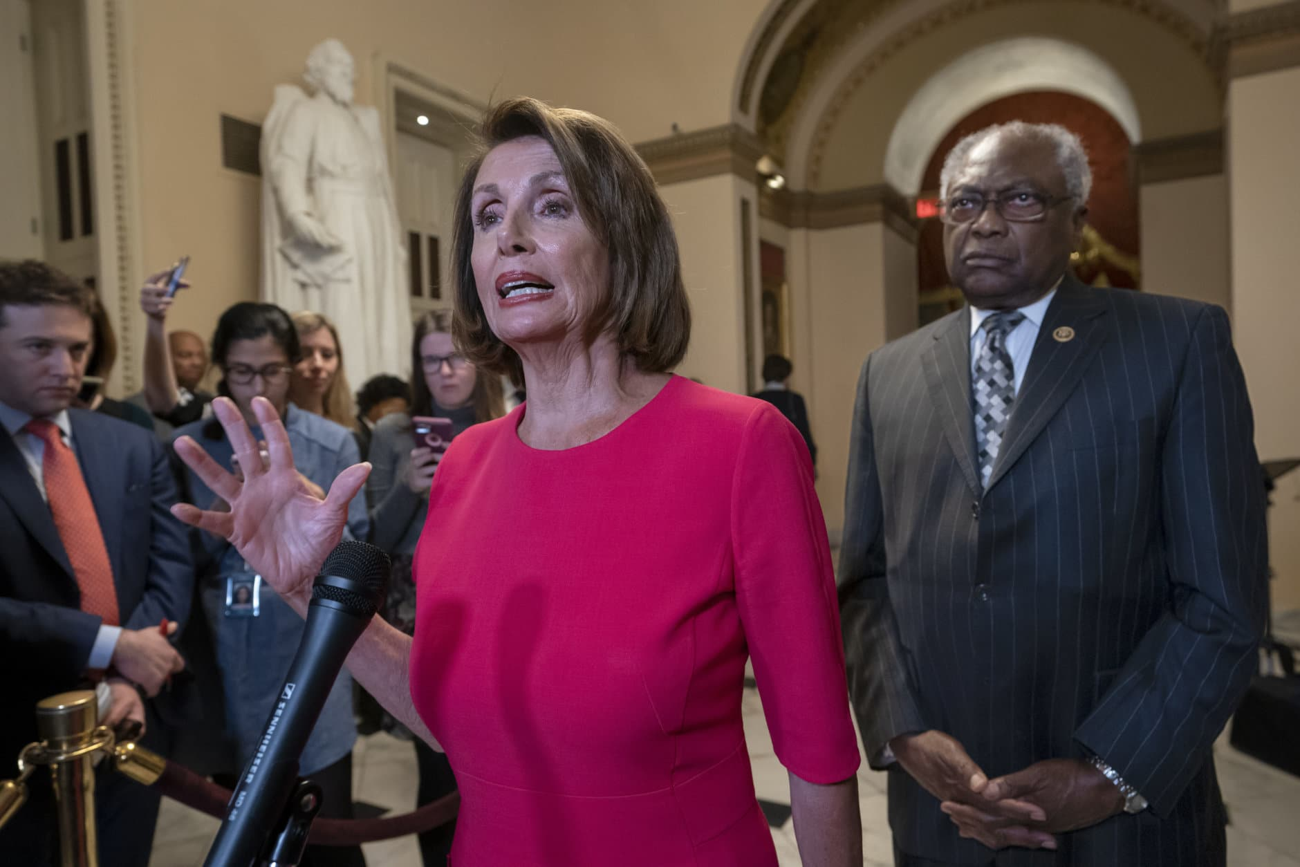Speaker of the House Nancy Pelosi, D-Calif., center, joined at right by Majority Whip James Clyburn, D-S.C., pushes back on President Donald Trump's demand to fund a wall on the US-Mexico border with the partial government shutdown in its second week, at the Capitol in Washington, Thursday, Jan. 3, 2019. (AP Photo/J. Scott Applewhite)