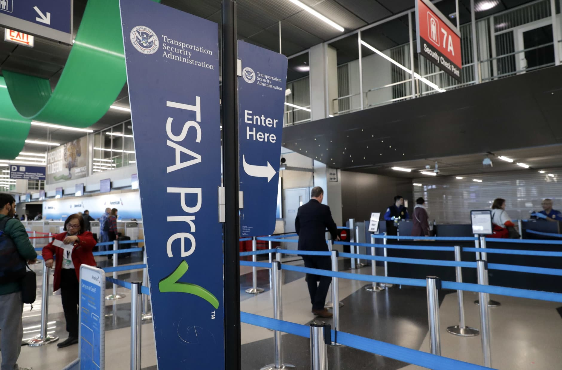 Transportation Security Administration checkpoint sign displays at O'Hare airport in Chicago, Saturday, Jan. 5, 2019. The TSA acknowledged an increase in the number of its employees calling off work during the partial government shutdown. (AP Photo/Nam Y. Huh)