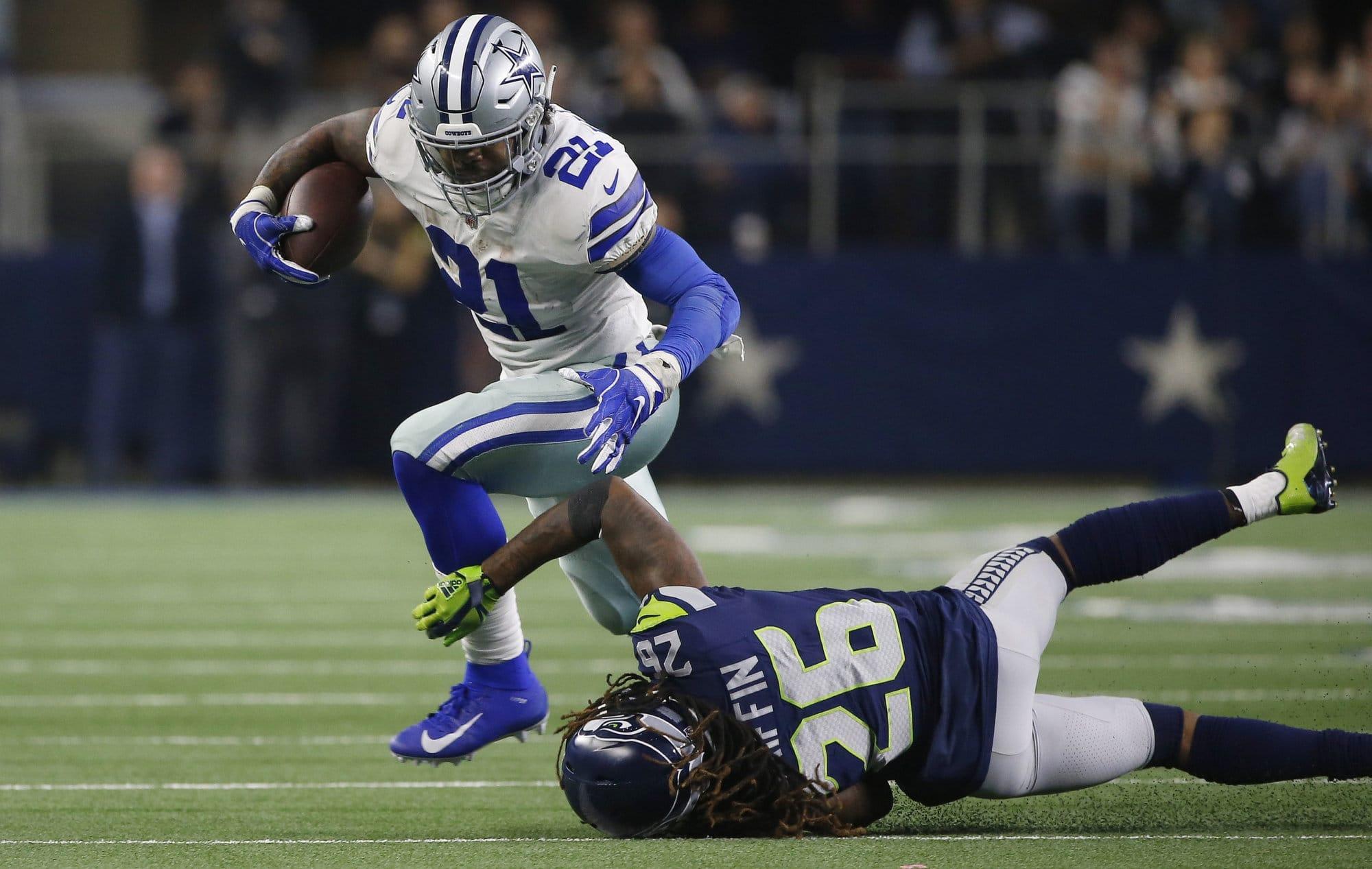 Dallas Cowboys running back Ezekiel Elliott (21) runs near Seattle Seahawks cornerback Shaquill Griffin (26) during the second half of the NFC wild-card NFL football game in Arlington, Texas, Saturday, Jan. 5, 2019. (AP Photo/Ron Jenkins)