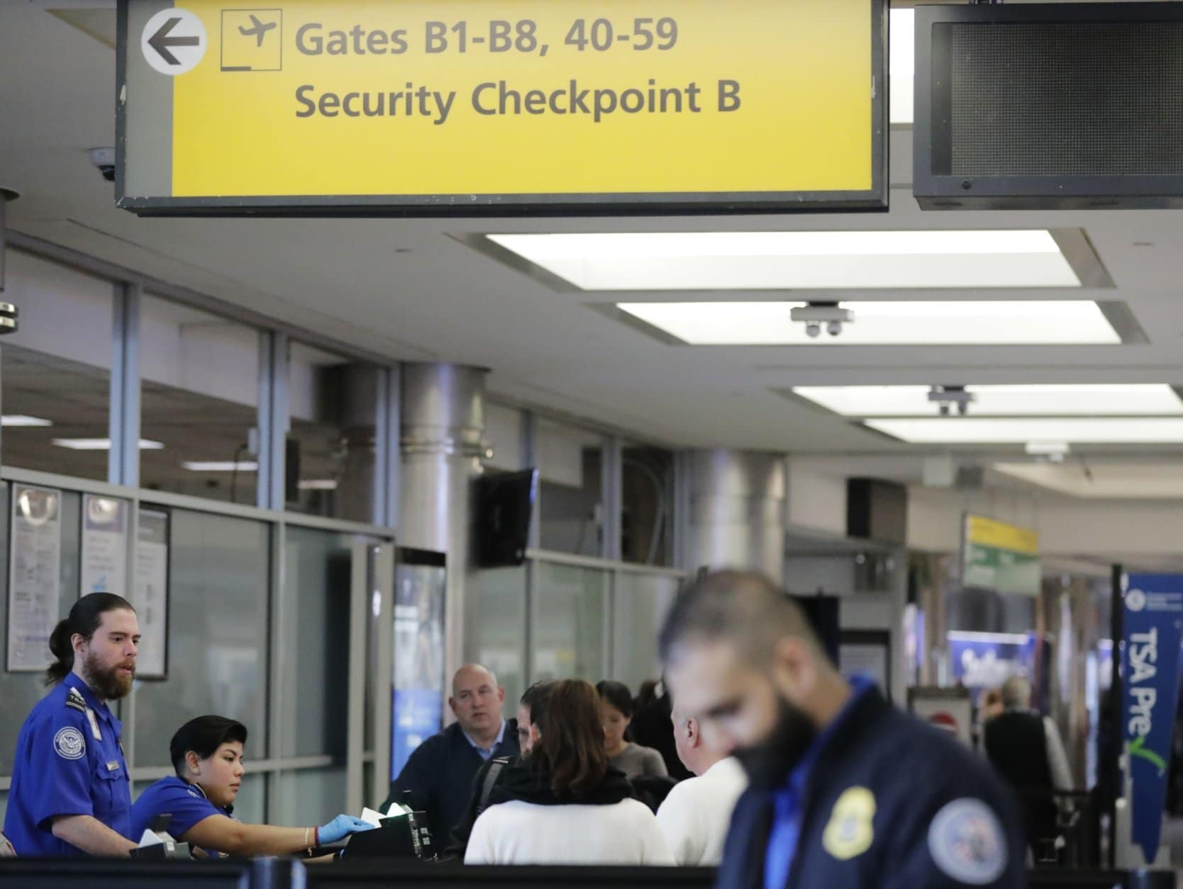 Passengers stand in line as they wait to pass through a Transportation Security Administration checkpoint at LaGuardia airport Monday, Jan. 7, 2019, in New York. (AP Photo/Frank Franklin II)