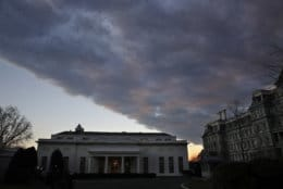 A cloud passes over the West Wing of the White House at sunset, Tuesday Jan. 8, 2019, a few hours before President Donald Trump is scheduled to make an address to the nation in Washington. (AP Photo/Jacquelyn Martin)