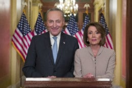 Senate Minority Leader Chuck Schumer of N.Y., and House Speaker Nancy Pelosi of Calif., pose for photographers after speaking on Capitol Hill in response President Donald Trump's address, Tuesday, Jan. 8, 2019, in Washington. (AP Photo/Alex Brandon)