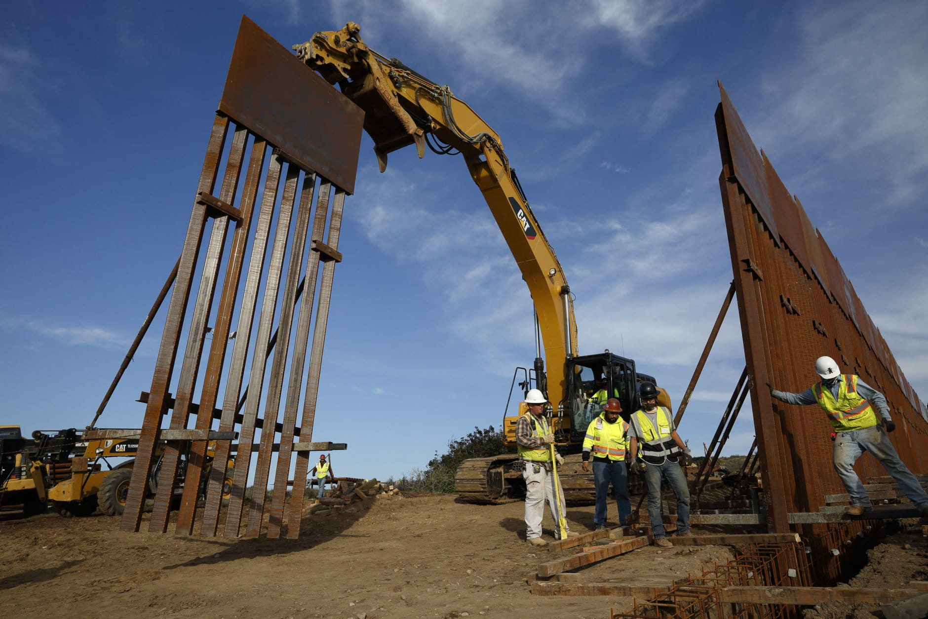 "Construction crews install new border wall sections Wednesday, Jan. 9, 2019, seen from Tijuana, Mexico. U.S. President Donald Trump walked out of his negotiating meeting with congressional leaders Wednesday — ""I said bye-bye,"" he tweeted— as efforts to end the 19-day partial government shutdown fell into deeper disarray over his demand for billions of dollars to build a wall on the U.S.-Mexico border. (AP Photo/Gregory Bull)"