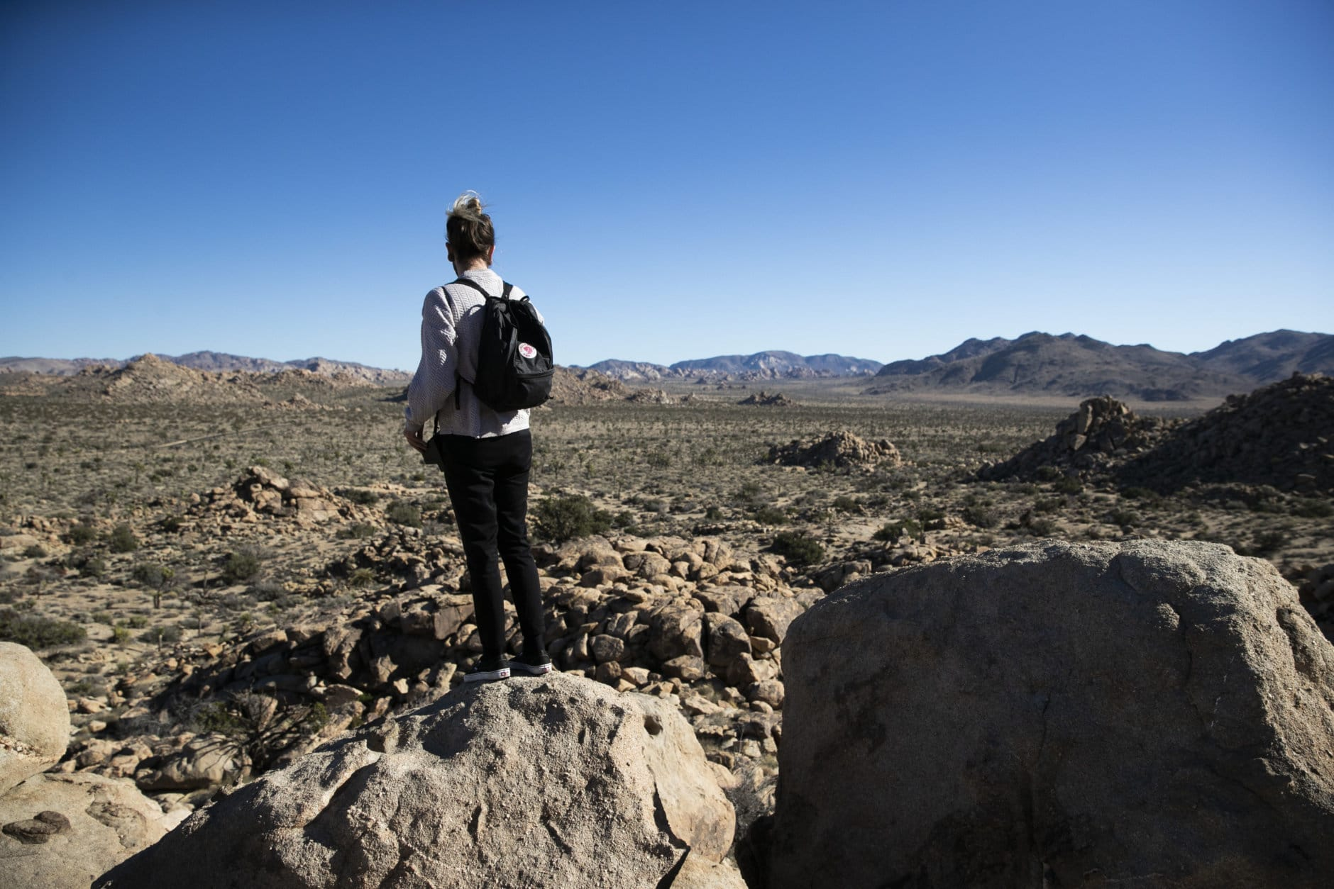 Trae Elliott visits Joshua Tree National Park in Southern California's Mojave Desert, Thursday, Jan. 10, 2019. The national park won't be closing because of the partial government shutdown after all. The desert preserve had planned to close on Thursday. As with other national parks, lack of staff had led to problems with human waste, trash and environmental damage. (AP Photo/Jae C. Hong)
