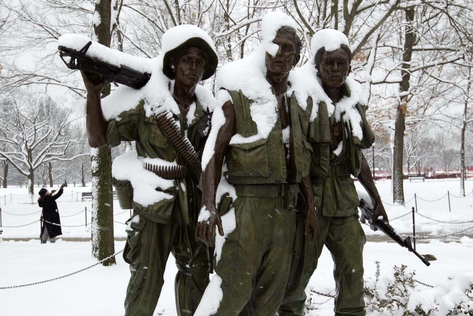 The Three Soldiers sculpture are covered in snow at Vietnam Veterans Memorial, during a snowstorm, as a partial government shutdown stretches into its third week at Capitol Hill in Washington Sunday, Jan. 13, 2019. With the standoff over paying for his long-promised border wall dragging on, the president's Oval Office address and visit to the Texas border over the past week failed to break the logjam and left aides and allies fearful that the president has misjudged Democratic resolve and is running out of negotiating options. (AP Photo/Jose Luis Magana)