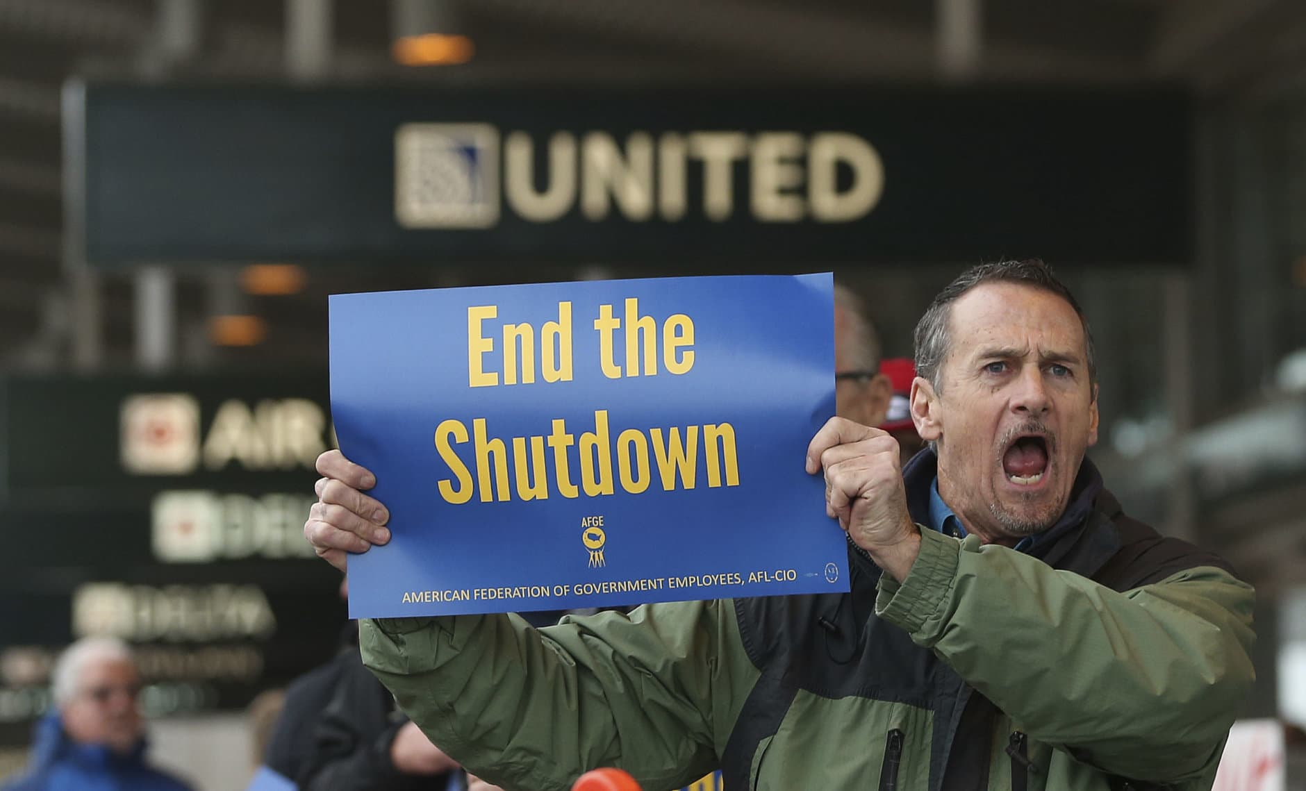 Several dozen federal employees and supporters demonstrated at the Sacramento International Airport calling for President Donald Trump and Washington lawmakers to end then partial government shutdown, Wednesday, Jan. 16, 2019, in Sacramento, Calif. (AP Photo/Rich Pedroncelli)
