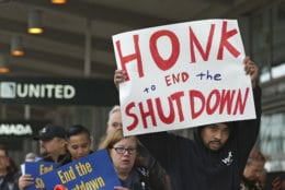 More than two dozen federal employees and supporters demonstrate at the Sacramento International Airport calling for President Donald Trump and Washington lawmakers to end then partial government shutdown, Wednesday, Jan. 16, 2019, in Sacramento, Calif. (AP Photo/Rich Pedroncelli)