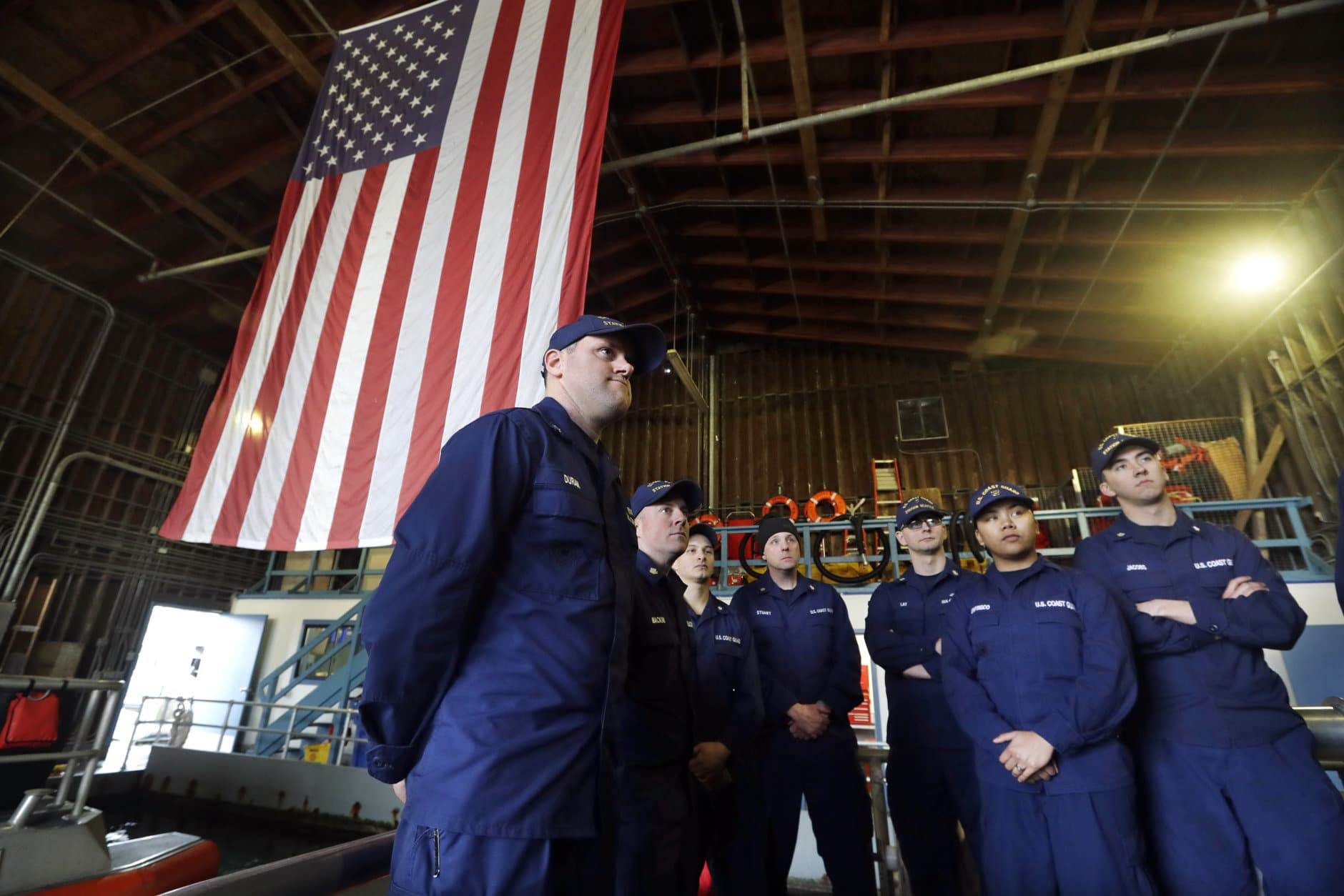 U.S. Coast Guardsmen and women, who missed their first paycheck a day earlier during the partial government shutdown, stand on a 45-foot response boat as they listen to their lieutenant during their shift at Sector Puget Sound base Wednesday, Jan. 16, 2019, in Seattle. They are part of a multi-mission, around-the-clock group charged with security and search and rescue missions. The Coast Guard is part of the U.S. Department of Homeland Security, which is unfunded during the partial government shutdown. (AP Photo/Elaine Thompson)