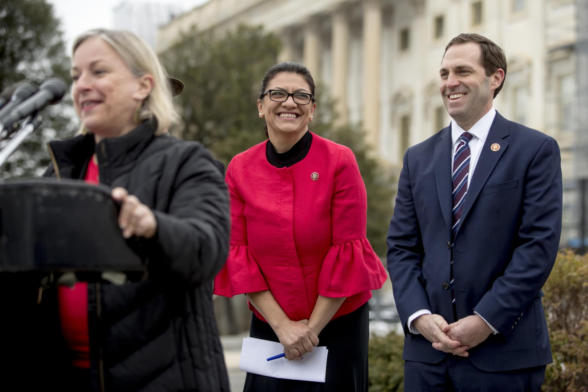 """Rep. Susan Wild, D-Pa., left, accompanied by Rep. Rashida Tlaib, D-Mich., center, and Rep. Jason Crow, D-Colo., right, speaks at a news conference on Capitol Hill in Washington, Thursday, Jan. 17, 2019, to unveil the """"Immediate Financial Relief for Federal Employees Act"""" bill which would give zero interest loans for up to $6,000 to employees impacted by the government shutdown and any future shutdowns. (AP Photo/Andrew Harnik)"""