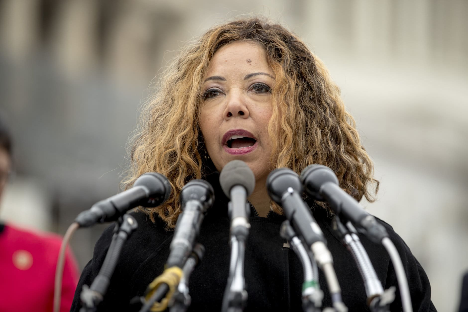 """Rep. Lucy McBath, D-Ga., speaks at a news conference on Capitol Hill in Washington, Thursday, Jan. 17, 2019, to unveil the """"Immediate Financial Relief for Federal Employees Act"""" bill which would give zero interest loans for up to $6,000 to employees impacted by the government shutdown and any future shutdowns. (AP Photo/Andrew Harnik)"""
