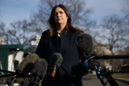 White House press secretary Sarah Huckabee Sanders listens to a question as she speaks with reporters outside the White House, Friday, Jan. 25, 2019, in Washington. (AP Photo/ Evan Vucci)