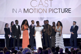"The cast of ""Black Panther,"" accept the award for outstanding performance by a cast in a motion picture at the 25th annual Screen Actors Guild Awards at the Shrine Auditorium & Expo Hall on Sunday, Jan. 27, 2019, in Los Angeles. (Photo by Richard Shotwell/Invision/AP)"