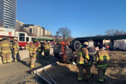 One person is in a hospital after their vehicle went over a bridge on Interstate 66 Monday morning. (Courtesy Arlington County Fire Department)