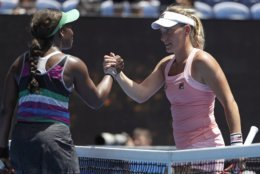 United States' Sloane Stephens, left, is congratulated by Hungary's Timea Babos after winning their second round match at the Australian Open tennis championships in Melbourne, Australia, Wednesday, Jan. 16, 2019. (AP Photo/Mark Schiefelbein)