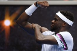 United States' Frances Tiafoe celebrates after defeating South Africa's Kevin Anderson in their second round match at the Australian Open tennis championships in Melbourne, Australia, Wednesday, Jan. 16, 2019. (AP Photo/Andy Brownbill)
