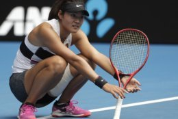 China's Wang Yafan reacts during her second round match against Australia's Ashleigh Barty at the Australian Open tennis championships in Melbourne, Australia, Wednesday, Jan. 16, 2019. (AP Photo/Mark Schiefelbein)