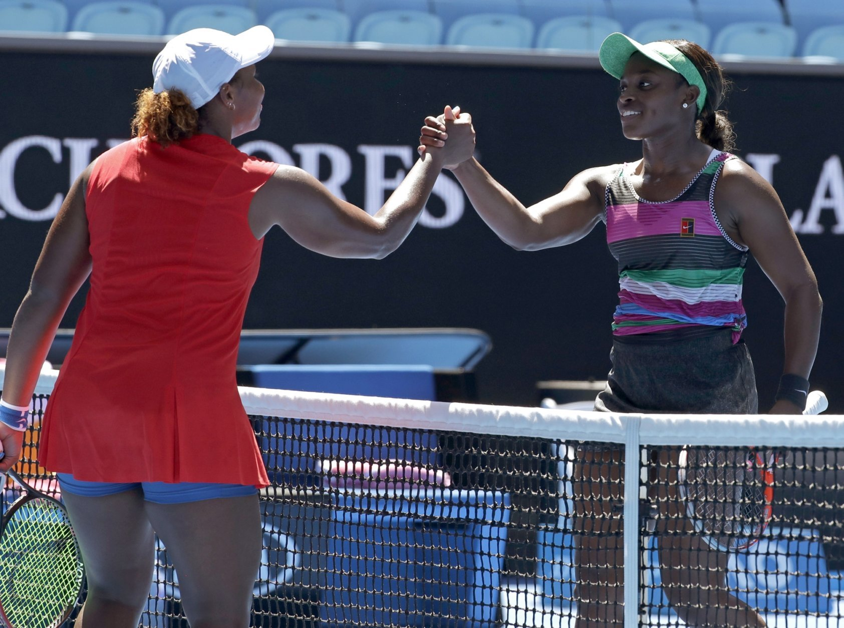 United States' Sloane Stephens, right, is congratulated by compatriot Taylor Townsend after winning their first round match at the Australian Open tennis championships in Melbourne, Australia, Monday, Jan. 14, 2019. (AP Photo/Kin Cheung)