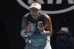 Japan's Naomi Osaka reacts after losing a point to Ukraine's Elina Svitolina during their quarterfinal match at the Australian Open tennis championships in Melbourne, Australia, Wednesday, Jan. 23, 2019. (AP Photo/Kin Cheung)