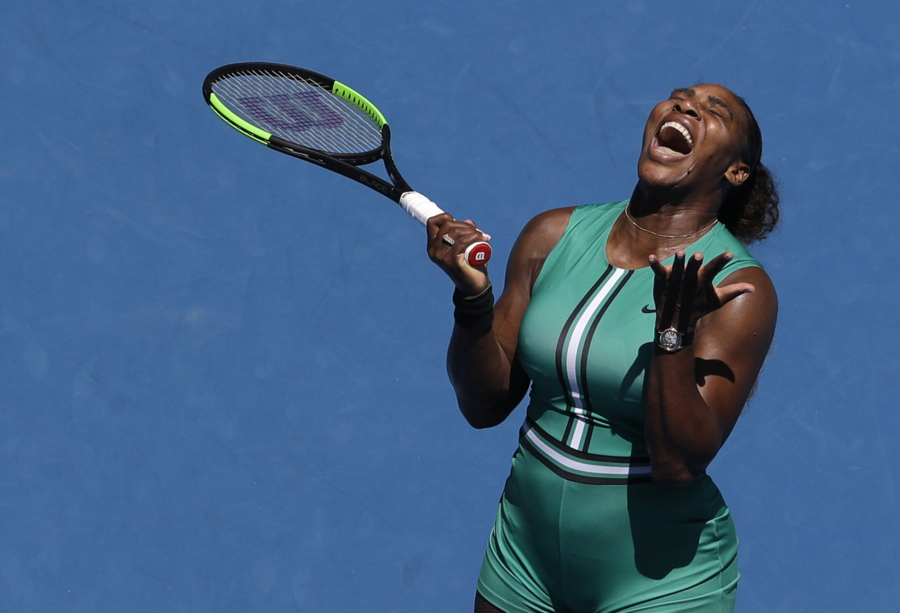 United States' Serena Williams reacts after losing a point to Karolina Pliskova of the Czech Republic during their quarterfinal match at the Australian Open tennis championships in Melbourne, Australia, Wednesday, Jan. 23, 2019. (AP Photo/Mark Schiefelbein)