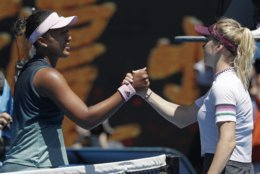 Japan's Naomi Osaka, left, is congratulated by Ukraine's Elina Svitolina after winning their quarterfinal match at the Australian Open tennis championships in Melbourne, Australia, Wednesday, Jan. 23, 2019. (AP Photo/Kin Cheung)