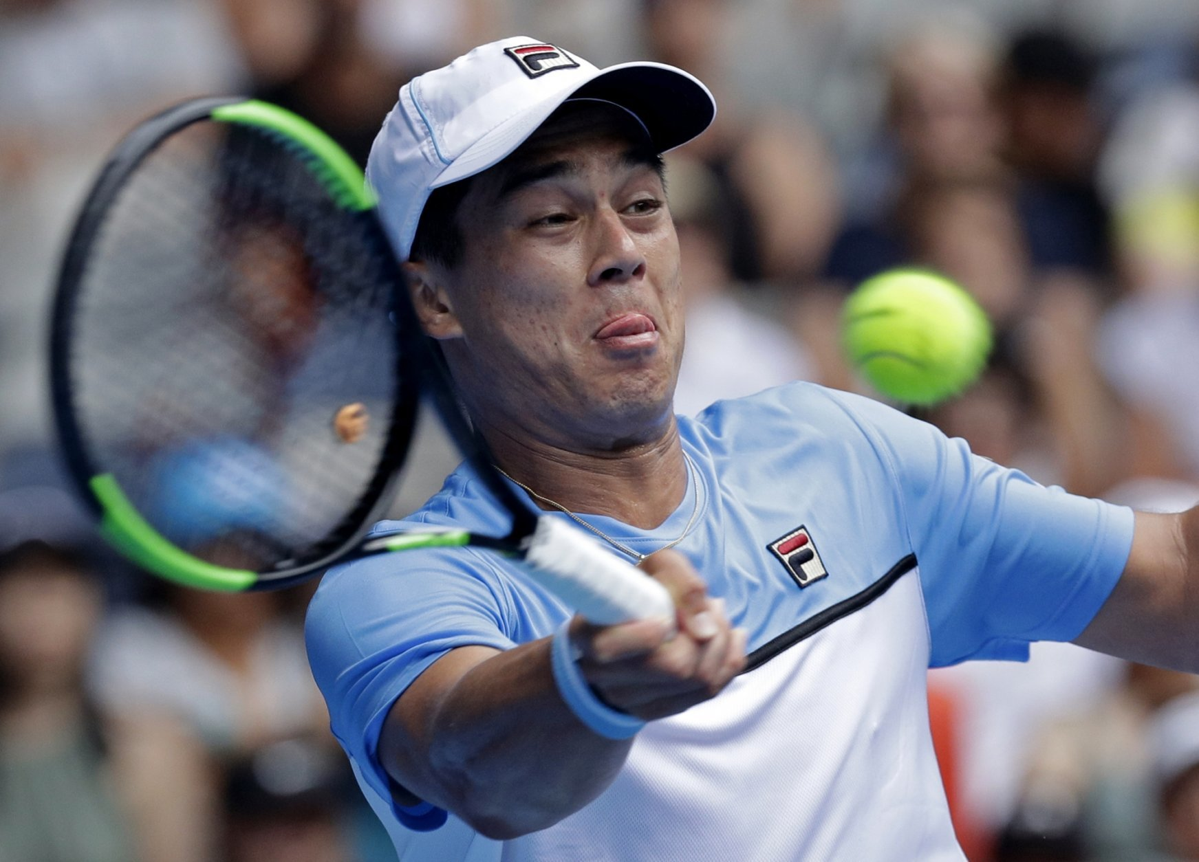 United States' Mackenzie McDonald hits a forehand return to Croatia's Marin Cilic during their second round match at the Australian Open tennis championships in Melbourne, Australia, Wednesday, Jan. 16, 2019. (AP Photo/Kin Cheung)