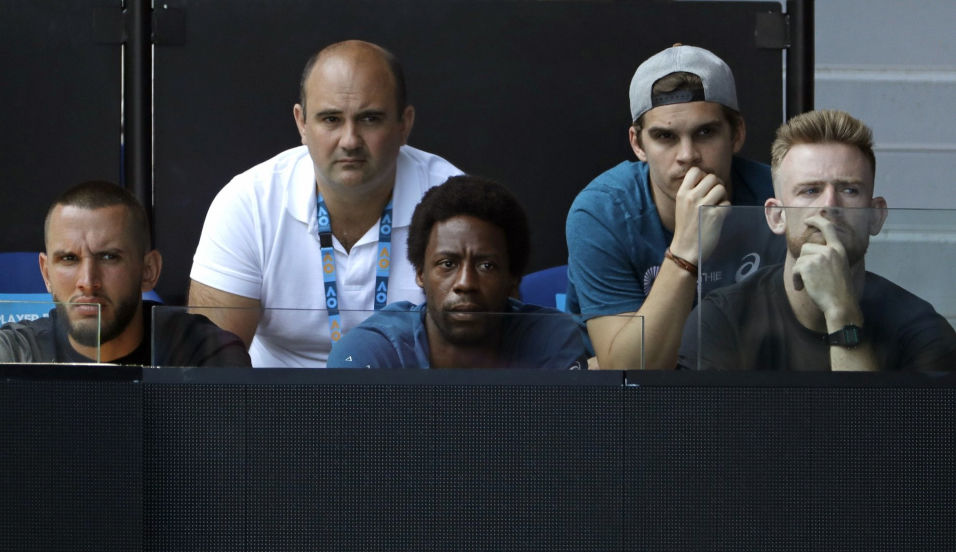 Gael Monfils sits in the players box of Ukraine's Elina Svitolina during her quarterfinal match against Japan's Naomi Osaka at the Australian Open tennis championships in Melbourne, Australia, Wednesday, Jan. 23, 2019. (AP Photo/Mark Schiefelbein)