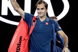 Switzerland's Roger Federer waves to the crowd after defeating Uzbekistan's Denis Istomin during their first round match at the Australian Open tennis championships in Melbourne, Australia, Monday, Jan. 14, 2019. (AP Photo/Aaron Favila)