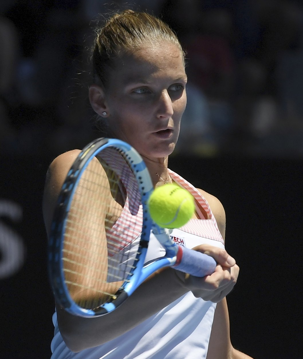 Karolina Pliskova of the Czech Republic makes a forehand return to United States' Serena Williams during their quarterfinal match at the Australian Open tennis championships in Melbourne, Australia, Wednesday, Jan. 23, 2019. (AP Photo/Andy Brownbill)
