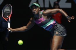 United States' Sloane Stephens looks to make a forehand return to Hungary's Timea Babos during their second round match at the Australian Open tennis championships in Melbourne, Australia, Wednesday, Jan. 16, 2019. (AP Photo/Mark Schiefelbein)