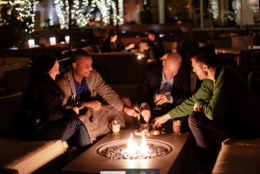 The new outdoor space, with fountain, is a sunken garden with fire pits and comes with blankets for guests to stay warm, and fondue to make it winter-cozy. (Courtesy Blue Duck Tavern)
